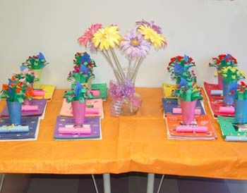 Preschool Mothers Day Crafts | The flower bouquets being presented on my daughter's classroom table