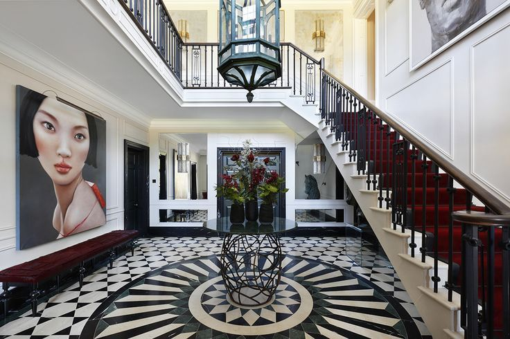 This foyer is just perfect. Why, you ask? Just look at the imposing artwork, the sophisticated use of the colour 'marsala', the black and white floor design and the huge lantern in the middle of the area.  📷: Rebecca James  #homedecor #interiordesign #entrywaydecor #architecture