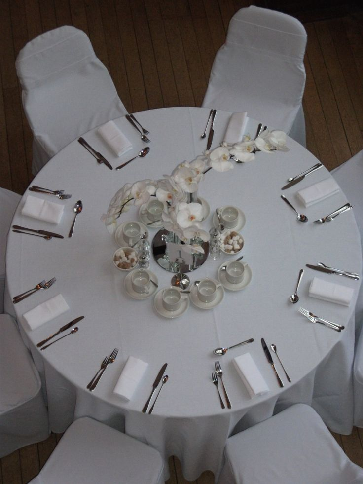 Elegant white orchid table centres.  Brides choice as part of a mid week wedding package deal