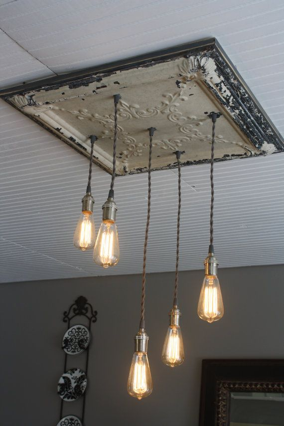 This is an Antique Tin Chandelier with Edison by KooteniaDesigns