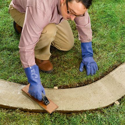 How to do poured concrete border. I kinda like this idea Tom. I could make desighns in it and you could mow over it too..... #garden_edging_border