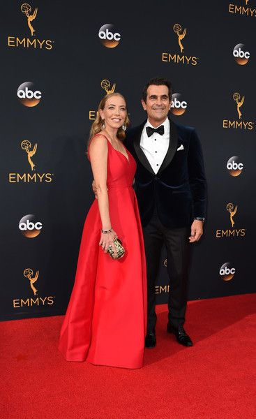 Ty Burrell (R) and spouse Holly Burrell arrive for the 68th Emmy Awards on September 18, 2016 at the Microsoft Theatre in Los Angeles.  / AFP / Robyn Beck