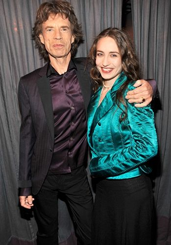Mick Jagger and his daughter Elizabeth Jagger pose for the camera at the 53rd Annual GRAMMY Awards.