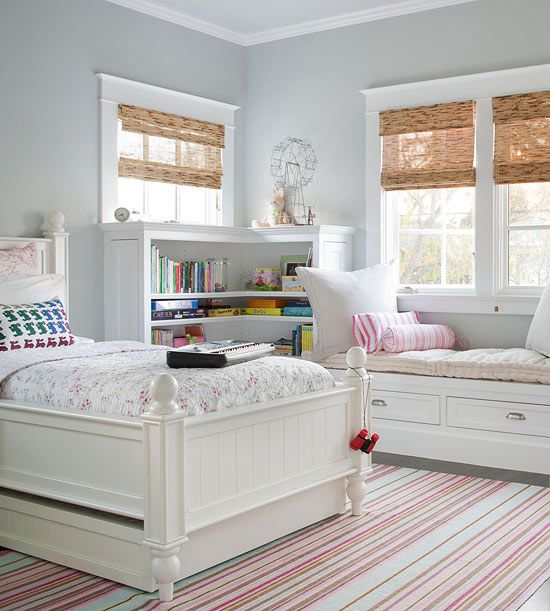 window molding; corner bookcase with built-in window seat; bamboo blinds