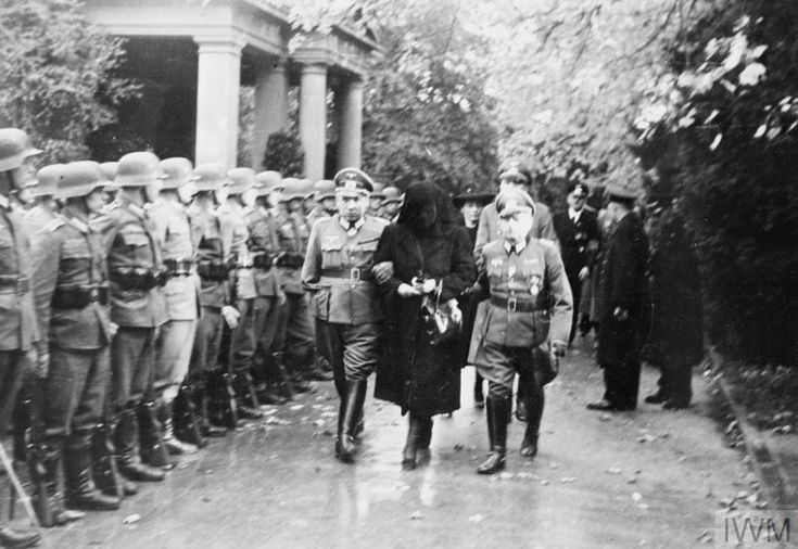 THE STATE FUNERAL OF FIELD MARSHAL ERWIN ROMMEL, 18 OCTOBER 1944 - Rommel's widow leaving the crematorium, supported by Rommel's brothers.