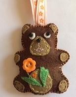 Brown teddy w orange flower