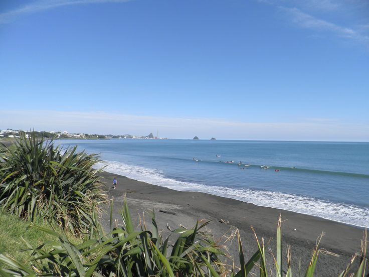 Surfboard lessons at East End beach, New Plymouth.