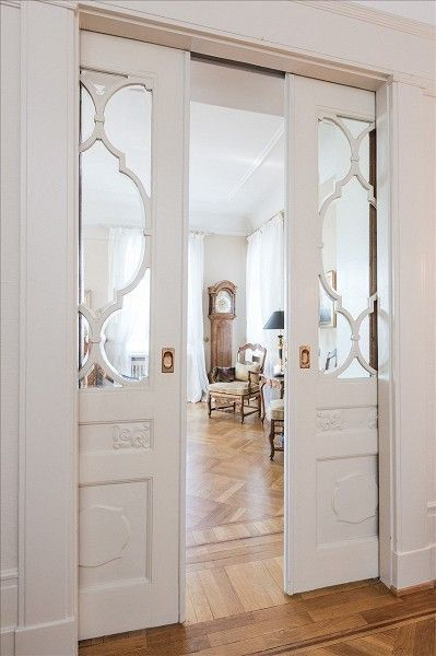 Charming double pocket door with arabesque glass inserts ~ perfect farmhouse decor.