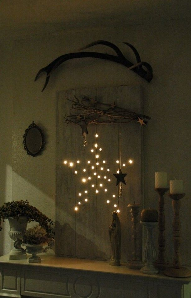 Mijn kerstdecoratie van dit jaar gemaakt van 2 planken 2 latjes slinger met 50 lampjes