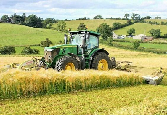 John Deere 7280r with Claas Disco triple mowers mowing barley for wholecrop silage