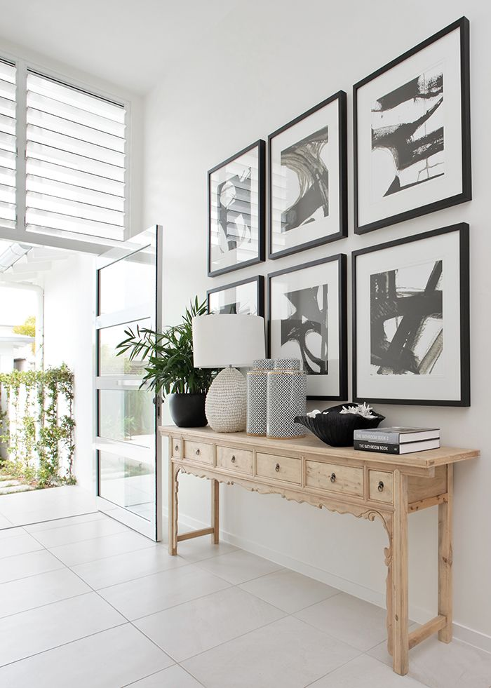 Make a statement with bold artwork, like this entry hall designed by Gail Hinkley Design. Photo: Anastasia Kariofyllidis. http://www.queenslandhomes.com.au/noosa-holiday-home/