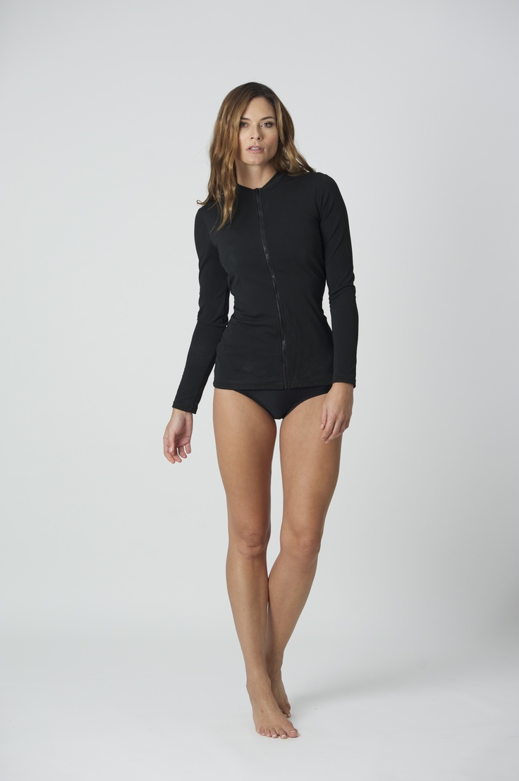Brashie: SPF 50, Rash Top,  Italian Lycra, lined with power mesh for figure flattering fit.  This unique design has its own built in supportive bikini top.   Extremely flattering and supportive, BAZ original design.