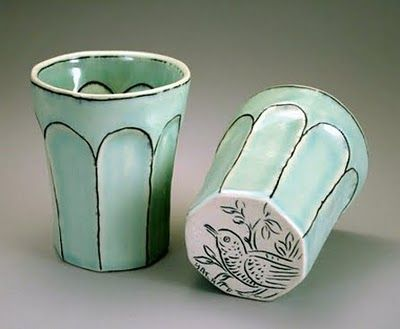 Molly Hatch, blue green ceramic cups, bird carvings on bottom