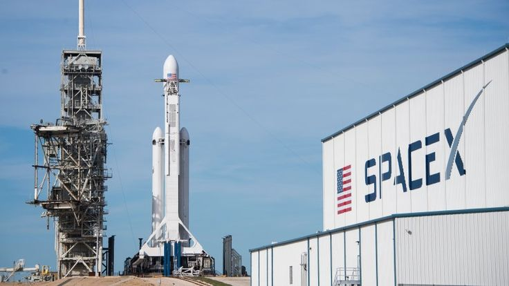 Watch live as new SpaceX jumbo rocket shoots a Tesla into space