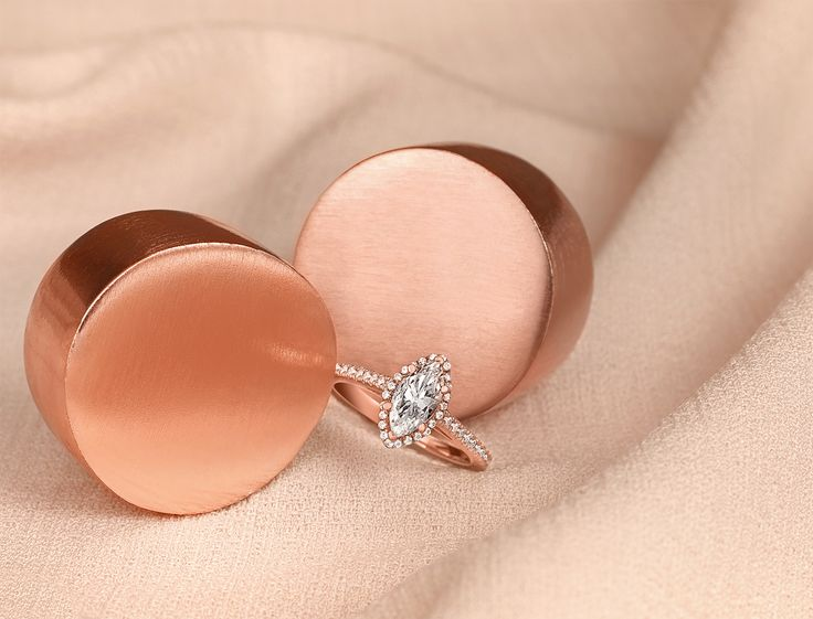 Pretty in pink! We are feeling extra special with this gorgeous Marquise cut diamond halo engagement ring set in rose gold from our timeless classic collection.