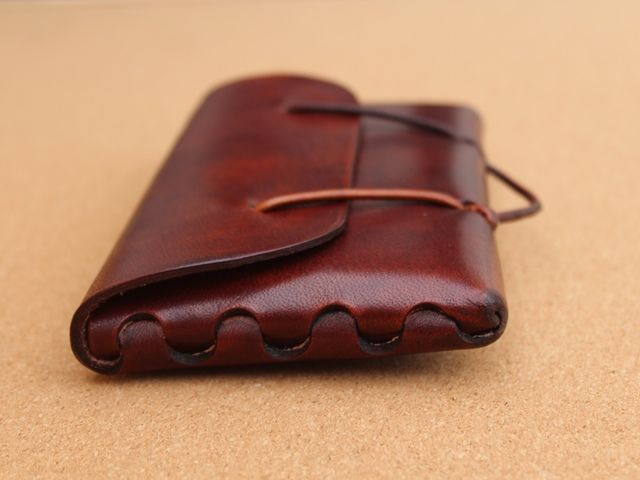 An EDC pouch made out of a single piece of leather, origami style- stitches leather work