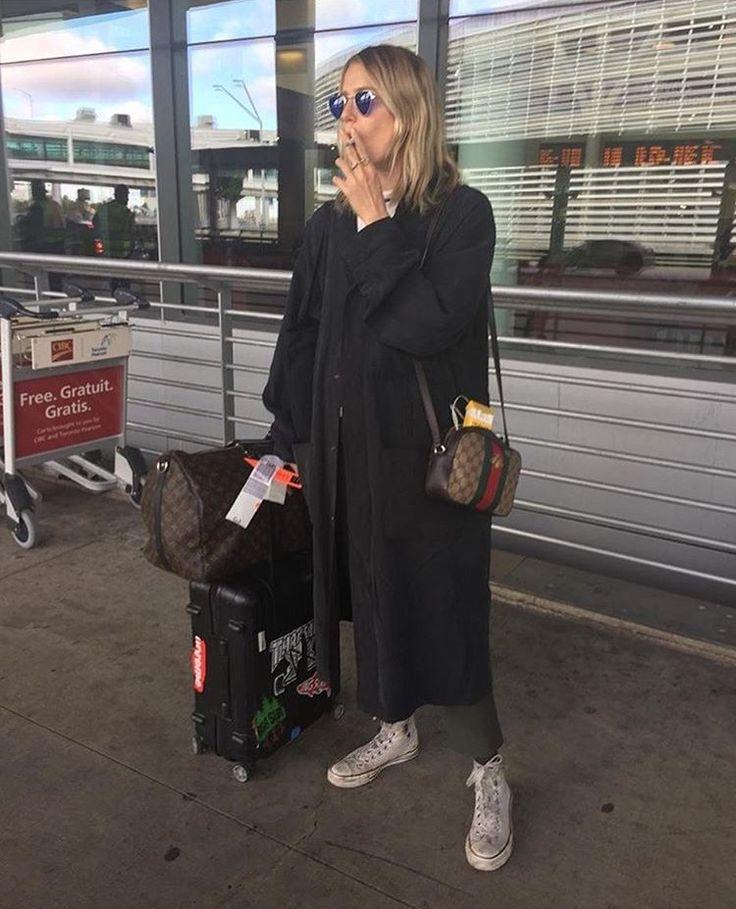 long parka coat, bag, round sunglasses, white sneakers