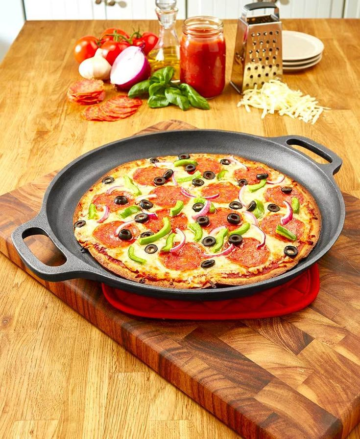 This Cast Iron Pizza Pan evenly distributes heat for a perfectly crisp crust and gooey, melted cheese. It features 2 handles for safe carrying. Can be used on t