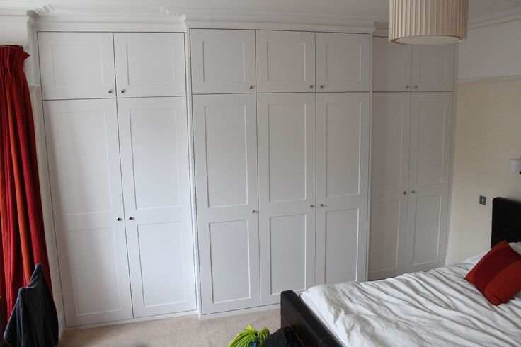 Wardrobe fitted around the chimney with Victorian coving (East Putney)
