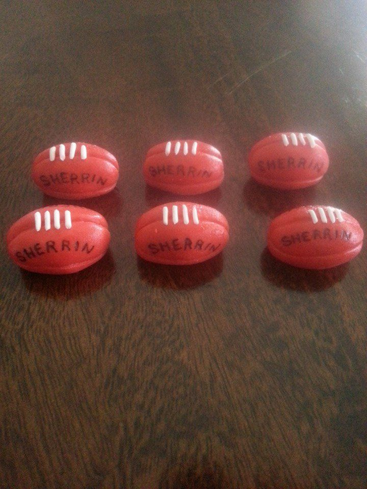 AFL Sherrin Football cupcake toppers made with homemade marshmallow fondant