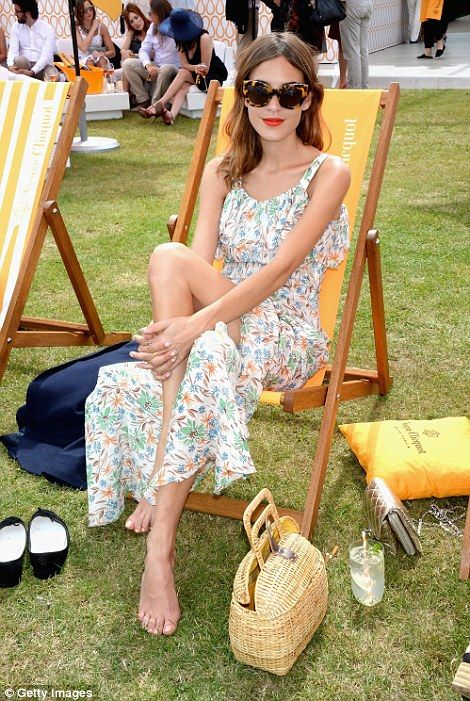 Alexa Chung sits back and her slender frame is all the more obvious. She dons her 1950's s...