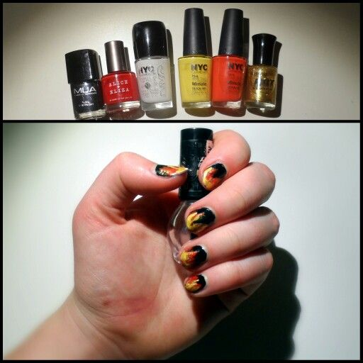 My firey nails as tribute to Mockingjay when I went to se it in the cinema!