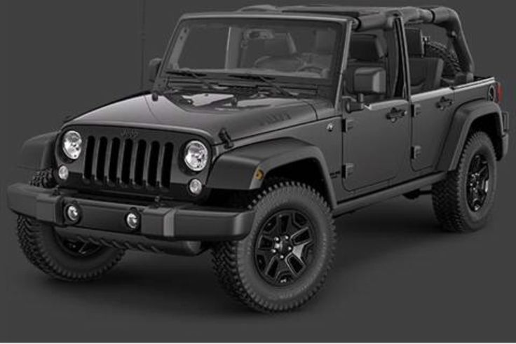 gray Jeep Wrangler. Blacked out tires. Soft top.