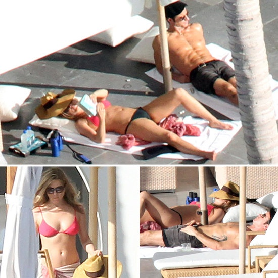 Bikini-Clad Jennifer Aniston Sunbathes in Cabo With Shirtless Justin on Christmas Eve!: Jennifer Aniston and Justin Theroux wasted no time getting into the sun on Monday during their Cabo Christmas and NYE vacation. Jennifer sported a pink and black mismatched bikini to soak in the rays while shirtless Justin showed off his perfect washboard abs. Jen was immersed in her book, and Justin relaxed and checked out the scene. Jennifer and Justin arrived in Mexico on Sunday afternoon for their…