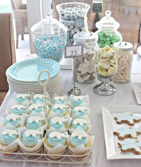 this was for a baby boy shower but im pinning it for the candy bar idea i need to find mason jars vases hurricane jars things to fill for candy