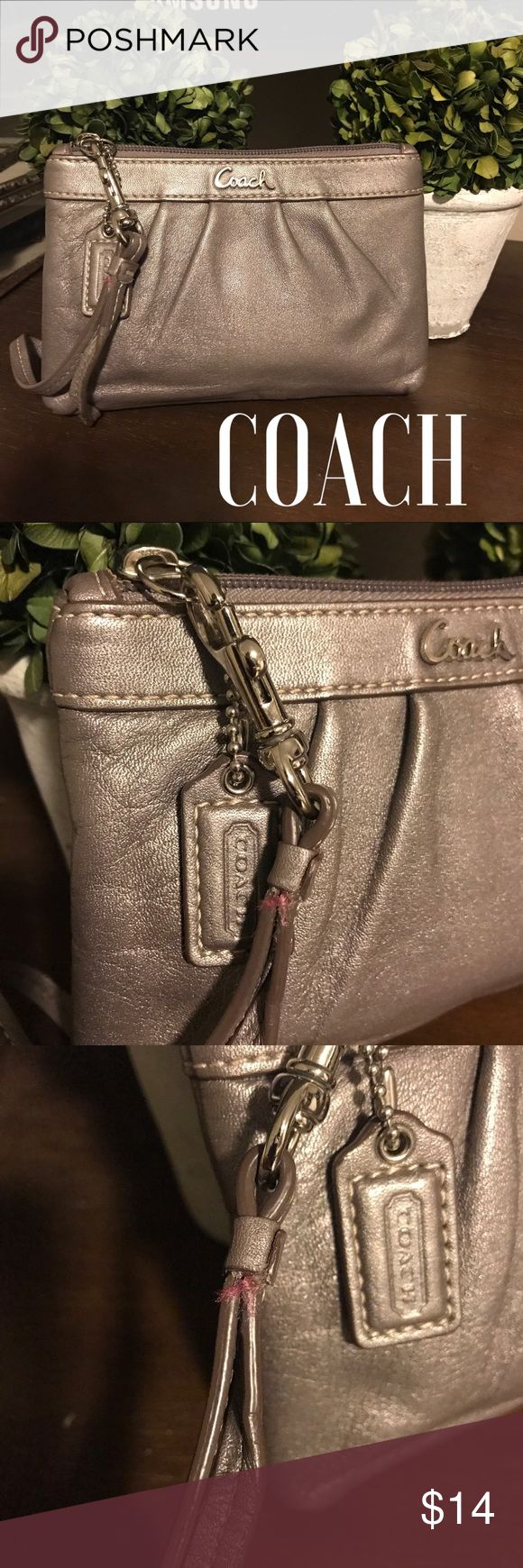 Coach Zippered Pouch In good preowned condition, charming pewter colored leather zippered pouch. Please note last photo were strap has beenReattached with professional grade leather glue. Otherwise no scratches or wearing a leather and clean interior. Coach Bags Clutches & Wristlets