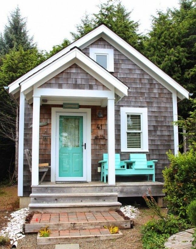 That aqua....22 Cozy Cottages You'll Want to Escape to This Weekend | Brit + Co