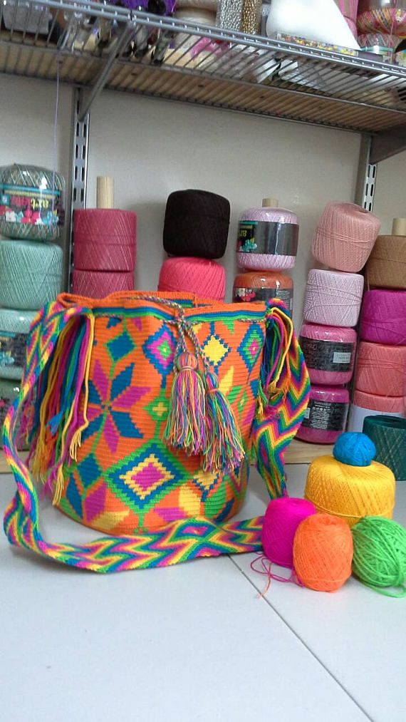 Check out this item in my Etsy shop https://www.etsy.com/listing/523609852/colombian-mochila-wayuu-bag-100-wayuu