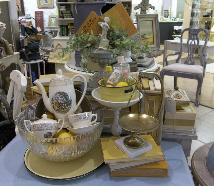 My yellow display at Frisco Mercantile-showcasing vintage items with a few painted decor pieces. August 2013