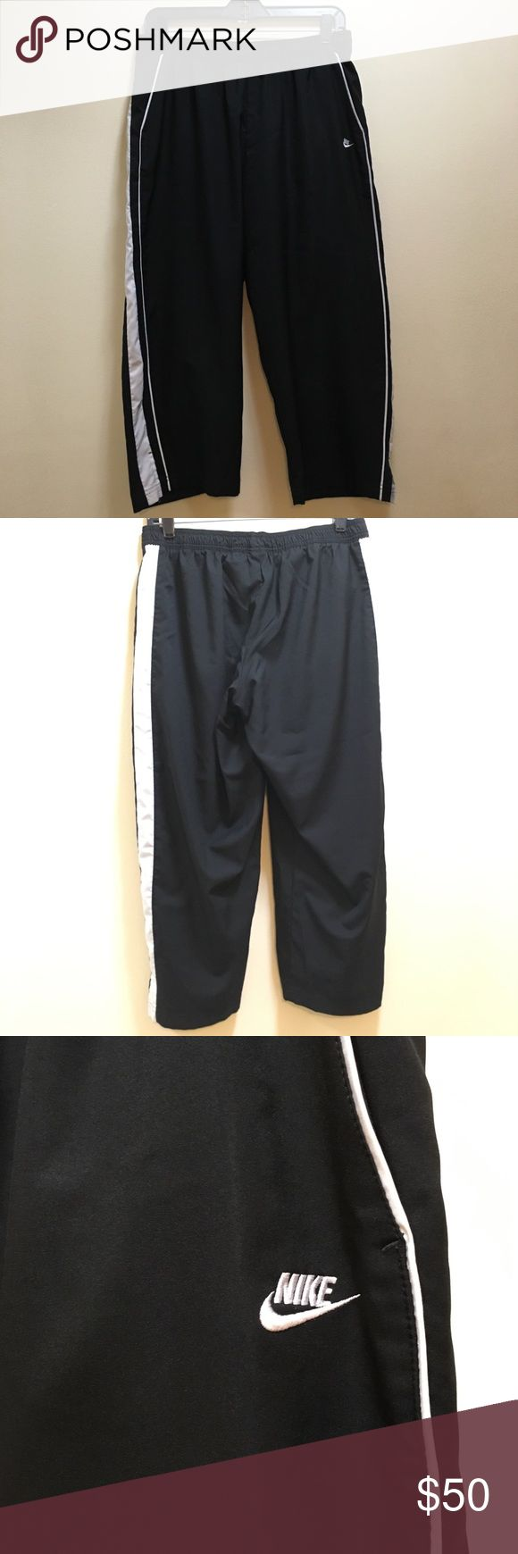 "Sz Large Nike Women's Cropped Active Pants Very very gently worn, great condition.  Cropped at 22.5"" inseam 10"" rise Slits at bottom  Front pockets  Super soft polyester! These do not have a drawstring, just stretchy at top. (In case that makes a difference to you!) Black with white stripes on sides Nike Pants Track Pants & Joggers"