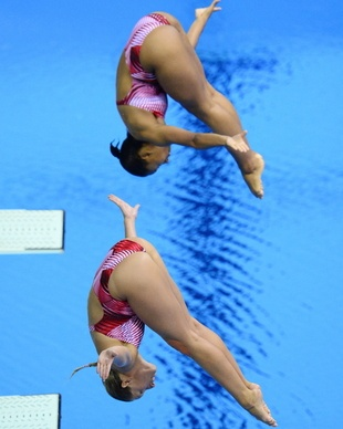 Jennifer Abel (top) and Emilie Heymans have Canada's first Olympic medal