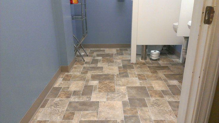 Newtarkett sheet vinyl installed in restroom of local for Floor sheet for office