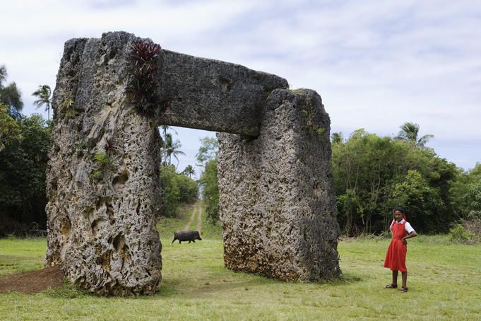 Ha'amonga 'a Maui Trilithon monument, Tonga  Schoolgirl visiting the Ha'amonga 'a Maui Trilithon monument.