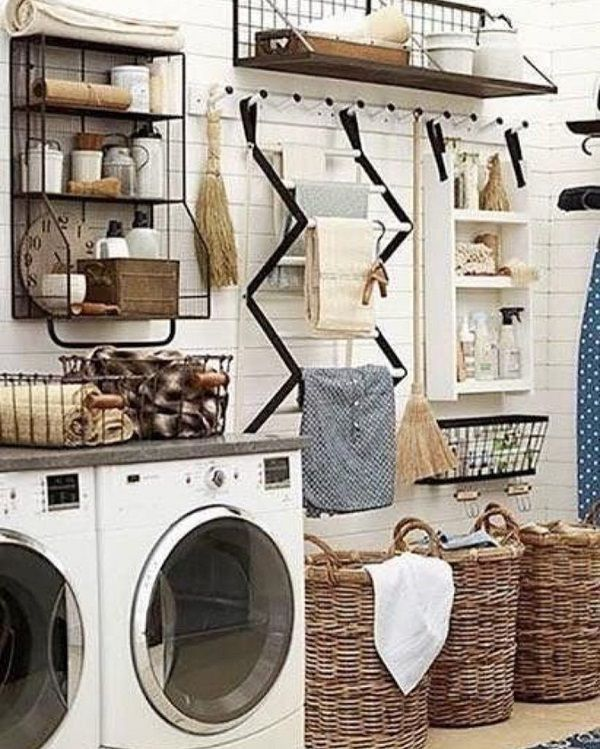Check out this laundry room decor idea with great organization. Love it! #LaundryRoomDesign #HomeDecorIdeas @istandarddesign