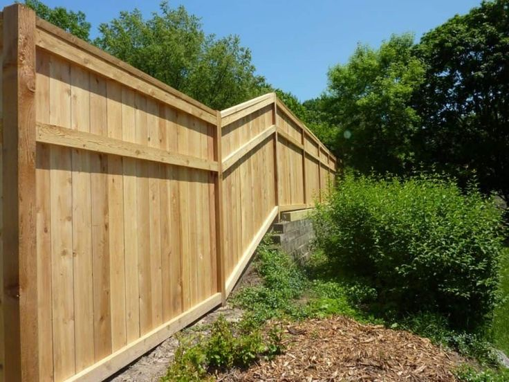 instructions to build fences on a slope in 2020 fence on inexpensive way to build a wood privacy fence diy guide for 2020 id=54741