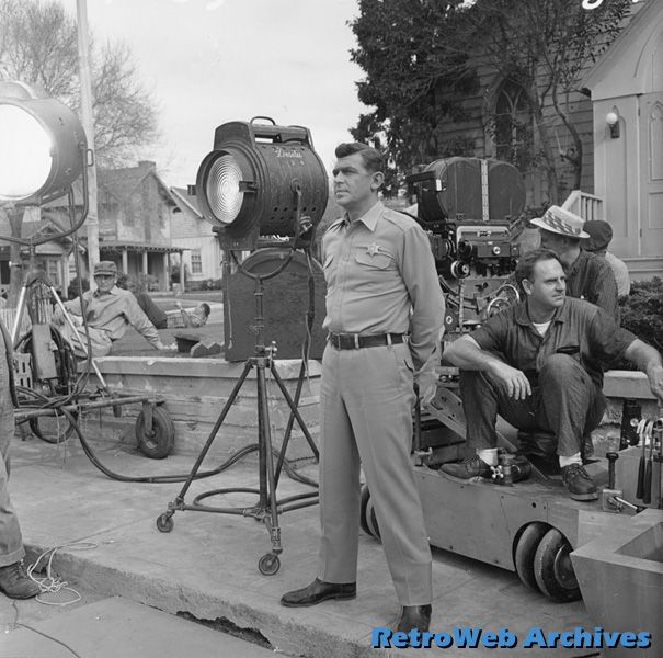 "Andy Griffith during a filming break on the Desilu Studios ""40 Acres"" backlot"