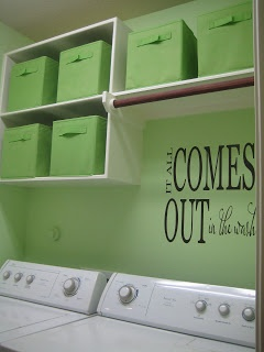 Great idea for storage over the washer and dryer. The only thing I would change would be to put a door on the cabinet .