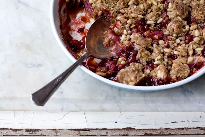 Strawberry Rhubarb Crumble - A simple spring crumble - rhubarb, strawberry, and a splash of port wine with a buttery black pepper, pine nut and oat crumble top. Sounds a bit fancy, but really, it couldn't be easier to make.