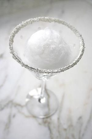 """Snowball Martini...A Martini glass, rimmed with sugar or white non-perils, """"ball"""" of white cotton candy, 2 oz Whipped Cream flavored Vodka, 1 oz lemon juice. In ice-filled shaker, put in 2 oz of whipped cream vodka and 1 oz of lemon juice. Shake well. Strain over the cotton candy, """"melting"""" the snowball and infusing the cocktail with sweetness. by gertrude"""