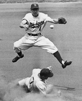 Pee Wee Reese was at shortstop for the Dodgers from 1940 to 1958. He played in 2,166 games and hit .269 for his career. He was inducted to the Baseball Hall of Fame in 1984, the same year the Dodgers retired his jersey (no. 1).