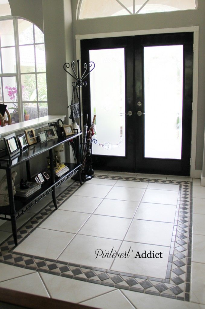 Love this- changed the whole vibe in her house! Painted floor tiles