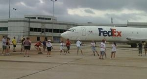Ingersoll Rand had a team compete in the 2011 FedEx Plane Pull Challenge to raise funds and awareness for nearly 10,000 Indiana Special Olympics athletes. The teams had to pull an airplane 12 feet while being timed! The best time won! Here is a team from Ingersoll Rand pulling an airplane manufactured by Boeing Company.  Find out how Ingersoll Rand did in the competition here:  https://plus.google.com/b/103802203022622346765/103802203022622346765/posts/hUgmwPTAizJ