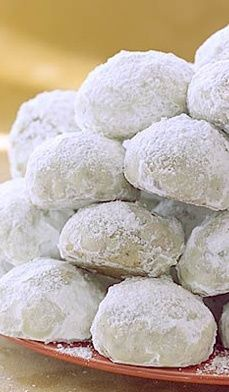 Snowdrops ~ Classic holiday cookies with the flavor of almonds or pecans and confectioner's sugar.