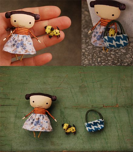 Little girl and her pet in a purse. I would change her head shape but it's cute ~!~