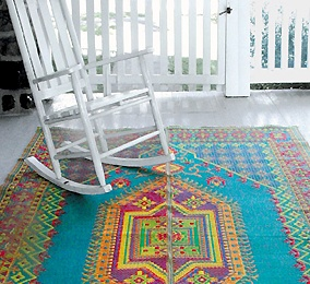 A recycled plastic rocker and a recycled plastic outdoor area rug- being green is stylish!