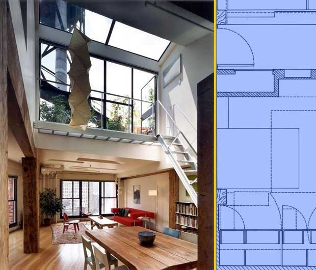 Il soffitto di questo loft, ricavato da un ex granaio, raddoppia l'altezza in corrispondenza di una parete di vetro che consente l'accesso al terrazzo e illumina l'ambiente
